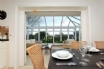 Dining area leading into the conservatory