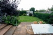 Garden with patio area and lawn