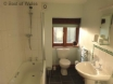 Ground floor bathroom with bath and shower over & heated towel rail.