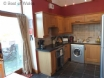 Kitchen includes oven, microwave, fridge freezer & washing machine.