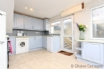 Spacious kitchen with dishwasher and washer/dryer