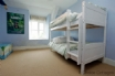 Children's room with white wooden bunk beds