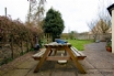 Large garden with picnic bench and chiminea