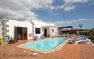 The gated pool and terrace area of this detached 3 bedroom villa