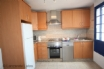 Sleek kitchen, with a dish washer hooray! and picture window to the garden and
