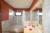 Ensuite with over bath shower, bidet, and a great mirror to check your tan