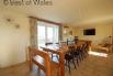 Large dining table for up to 14 guests and a large flat screen TV.