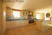 Top of the range cream painted oak kitchen with granite worktops.