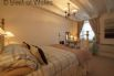Ensuite double bedroom featuring a lovely Victorian brass/iron bed