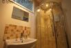 Separate shower room / toilet with shower cubicle, toilet and vanity unit
