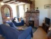 Cosy oak beamed open plan living / dining area with a brick fireplace.