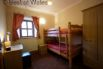 The third bedroom includes full size wooden bunk beds