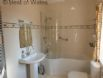 Family bathroom with wash hand basin, wc, bath & overhead shower.