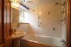 Ground floor bathroom with shower above bath