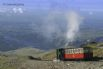 Conquer Snowdon (the highest mountain in Wales) by foot, or take the train to the top