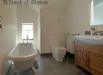 Main Bathroom- bath with cast iron feet, large solid oak washstand with mirror and shaver point.