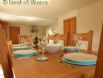 Dining area features large solid oak table and chairs with enough seating for up to 8 people.
