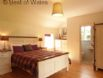 Double ensuite bedroom at this large holiday cottage in North Wales