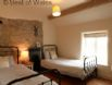 Second twin bedroom with original fireplace at this large holiday cottage