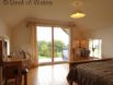 Ensuite master bedroom with balcony at this large holiday cottage