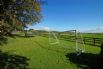 Family friendly cottage includes a football goal and trampoline in the garden