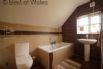 Bathroom with shower over centre of bath & heated towel rail