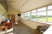 Conservatory serves as a lounge with fantastic views of Rhiw mountain.