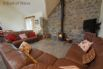 Spacious living area with leather sofas, log burner & flat screen TV