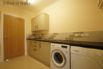 Utility room with a range of units, sink, washing machine, tumble dryer and drying room.