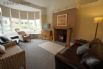 Lounge 1 with welcoming woodburner and 40 inch Smart TV