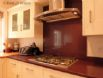 Kitchen includes a double oven, 5 ring gas hob and extractor hood