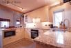 Beautiful, fully equipped oak kitchen includes a dishwasher and microwave