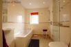 Ground floor wet-room with the shower door open.