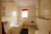 Ground floor wet-room with a shower, separate bath, wash basin and toilet.