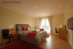 Spacious ground floor bedroom with a king size bed