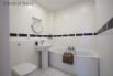 Family bathroom with bath and hand held shower hose, basin & WC