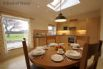 Kitchen / dining room overlooks the orchard and mountains on the horizon
