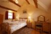 Bedroom 1 - Large room with oak double bed and wall mounted TV