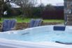 Large enclosed patio and garden area with a private hot tub