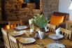 Dining table in front of a beautiful inglenook and woodburner