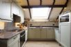 Fitted kitchen includes a microwave, electric cooker, fridge & dishwasher
