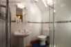 Upstairs shower room with toilet, heated towel rail and wash basin