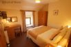 Bedroom 1 - double bed and wall mounted TV