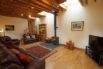 Very spacious living room with beams and oak flooring