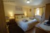 First floor double bedroom with countryside views in both directions