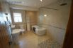Large bathroom with freestanding bath,  walk in shower and heated towel rail.