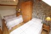 Second upstairs bedroom with three single beds
