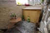 Sheltered, small and pretty rear courtyard with table and chairs