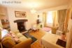 Beautiful and cosy living area with a welcoming  logburner and smart TV