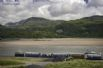 Take the minature train in Fairbourne to the Mawddach estuary where you can catch a boat to Barmouth (seasonal timetable)